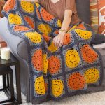 Halloween Pumpkin Crochet Throw. Granny square blanket crafted in Autumn, Fall colors    thecrochetspace.com
