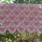 Heartfelt Crochet Baby Blanket. Crafted in pink and white || thecrochetspace.com