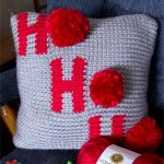 Holiday Ho Crochet Pillow . Crafted in grey and red || thecrochetspace.com