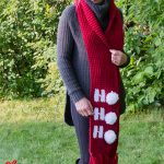 Holiday Ho Crochet Scarf. Long scarf worn at a distance. Three white pom poms || thecrochetspace.com