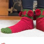 Holiday Ho Crochet Socks. Crafted in bright green and red with red pom poms || thecrochetspace.com