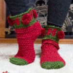 Holiday Ho Crochet Socks. Green toe tip and cuff. Red main sock and heel, with red pom poms || thecrochetspace.com