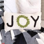 Holiday Joy Crochet Pillow. Cream pillow with black lettering and green wreath for O    thewcrochetspace.com