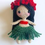 Hula Hula Crochet Girl.Hula Girl with red flower head garland, re band top and green grass skirt. Long flowing black hair    thecrochetspace.com