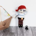 Amigurumi Pirate With A Left Eye Patch, A Red Handkerchief On His Head And A Stripy Long Sleeved Sweater || thecrochetspace.com