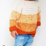 Kiddies Pumpkin Crochet Sweater. Worn with a pair of jeans | thecrochetspace.com