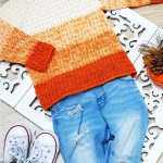 Kiddies Pumpkin Crochet Sweater. Placed with a pair of jeans | thecrochetspace.com
