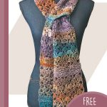 Lacy Keyhole Crochet Scarf. Crafted in autumnal colors and secured. Image shown on dummy    thecrochetspace.com