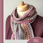 Lizzy's Lovely Crochet Scarf. Wrapped around model neck over a plum colored jacket || thecrochetspace.com