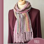 Lizzy's Lovely Crochet Scarf. Full front image of scarf worn over a plum jacket || thecrochetspace.com