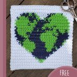 Loving Earth Crochet Square. White background square with blue and green heart in center || thecrochetspace.com