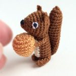 Micro Crochet Squirty Squirrel. Brown squirrel with beige acorn || thecrochetspace.com