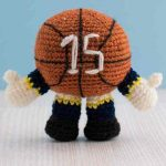 Mini Crochet Basketball Mascot. Round basketball with arms and legs. Rear side with jersey number 15 on the back || thecrochetspace.com