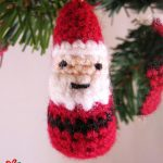 Mini Crochet Father Christmas. Small egg shaped santa crafted in red, white and black || thecrochetspace.com