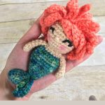 Mini Mermaid Crochet Rattle. Crafted with bright orange hair and a green tail || thecrochetspace.com