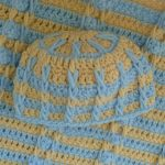 Minnie Layette Crochet Set. Close up of hat and blanket || thecrochetspace.com