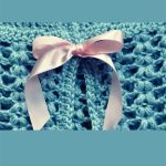 Misty Maine Crochet Cardigan. Close up of pink ribbon fastening || thecrochetspace.com