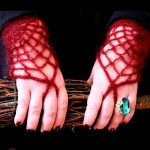 Morticia Adams Crocheted Gloves. Two hands holding broomstick bristles, side by side. Red Spider gloves and huge green ring on left hand || thecrochetspace.com