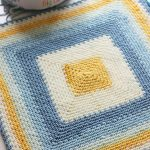 Mossy Square Crochet Blanket. Laid out with image enlarged of striped center || thecrochetspace.com
