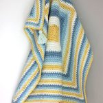 Mossy Square Crochet Blanket crafted in a self striping yarn || thecrochetspace.com