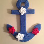 Close up of hanging anchor, which is not crocheted. Accents of crocheted stars in red, white and blue added to anchor || thecrochetspace.com