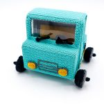 Pick Up Crochet Truck. Front View. Yellow headlights, window wiper blades and front grill. Truck in Turquoise    thecrochetspace.com