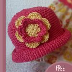 Pretty-Pixie Crochet Hat. Hat being held aloft and at an angle || thecrochetspace.com