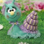 Pretty Crochet Sally Snail. Crafted in green and lavender || thecrochetspace.com