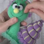 Pretty Crochet Sally Snail. Embroidering Sally's mouth || thecrochetspace.com