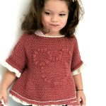 Pretty Minnie Crochet Top. Close up of little girl wearing top. Minni Mouse crafted in bubble stitch on the front in same color || thecrochetspace.com