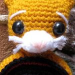 Puss In Crochet Boots. Close up of face with sombrero between teeth || thecrochetspace.com