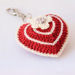 Quick Valentine Crocheted Heart. A single red filled Heart With A Cream Flower. Key Chain || thecrochetspace.com