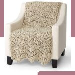 Rapid Ripple Crochet Afghan. Afghan has been neatly placed over seat and back of chair. Crafted in variegated oatmeal colors || thecrochetspace.com