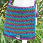 Retro-Crochet-Messenger-Bag. Flap over bag crafted in blue, pink and green stripes. Square with great button to secure || thecrochetspace.com
