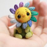 Sad Little Crochet Sunflower. Sitting in the palm of someone's hand || thecrochetspace.com