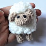 Sally Sheep Crochet Brooch. brooch being held || thecrochetspace.com