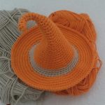 Seasonal Crochet Witches Hat. Orange hat with beige band around || thecrochetspace.com