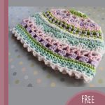 Shell Baby Crochet Beanie. Pretty white scalloped edging and pink/green lacy hat || thecrochetspace.com