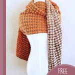 Shell Stitch Crochet Shawl. Shawl wrapped around plastic model with tail both sides of neck || thecrochetspace.com