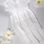 Simple Crochet Christening Gown. Crafted in white with round neck and short sleeves || thecrochetspace.com