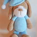 Sleepy Sonia Crochet Dog With Baby Blue Outfit And Pointed Sleep Hat With White Pom-Pom On The End || thecrochetspace.com