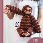 Sill Sloth Amigurumi Buddy. Child standing with sloth sitting in the palm of her hand || thecrochetspace.com