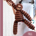 Sill Sloth Amigurumi Buddy. Little girl standing and stretching the sloth || thecrochetspace.com