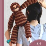 Sill Sloth Amigurumi Buddy. Sloth hanging over the back of little girls shoulder || thecrochetspace.com