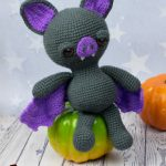 Spooky Halloween Bat. Bat sitting on an unripe tomato || thecrochetspace.com