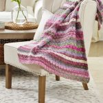 Spring Back Crochet Throw crafted in pinks and grey self striping yarn || thecrochetspace.com