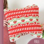 Strawberry Tapestry Crochet Pillow. One pillow being placed on a chair    thecrochetspace.com