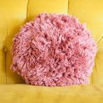 Super Shaggy Crochet Pillow. Round, dusky pink and shaggy    thecrochetspace.com