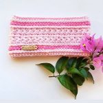 Sweetest Pea Crochet Headband. Pictured with a pink bouganvilla. Crafted in pale pink with dark pink Camel stitch rows || thecrochetspace.com
