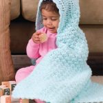 Textured Crochet Baby Blanket Hoodie. Crafted in a textured stitch in pale blue || thecrochetspace.com
